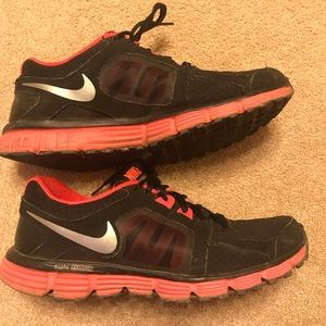 Black and pink Nike sneakers